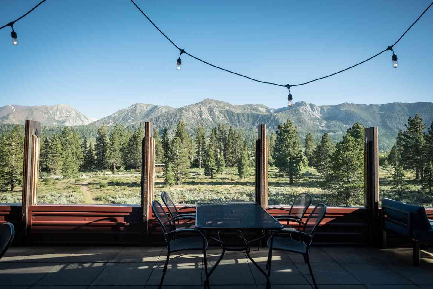 Patio seating area with a mountain view