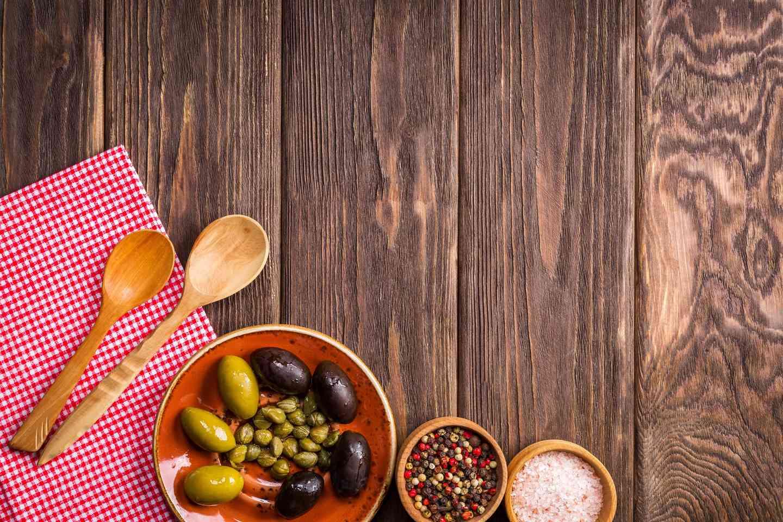 bowls of olives and seasonings