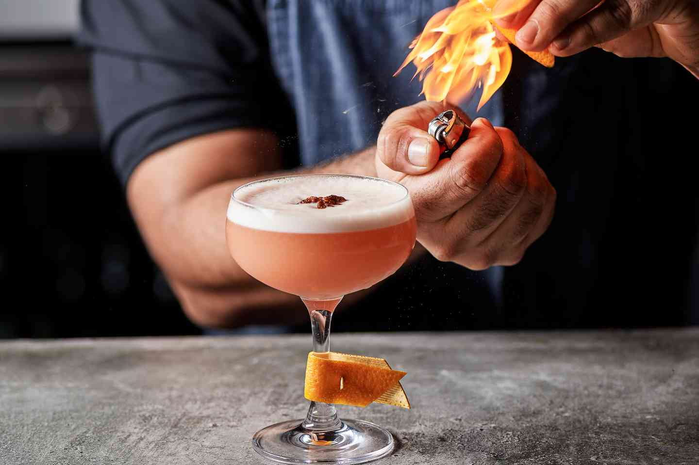 bartender making mixed drink with flame