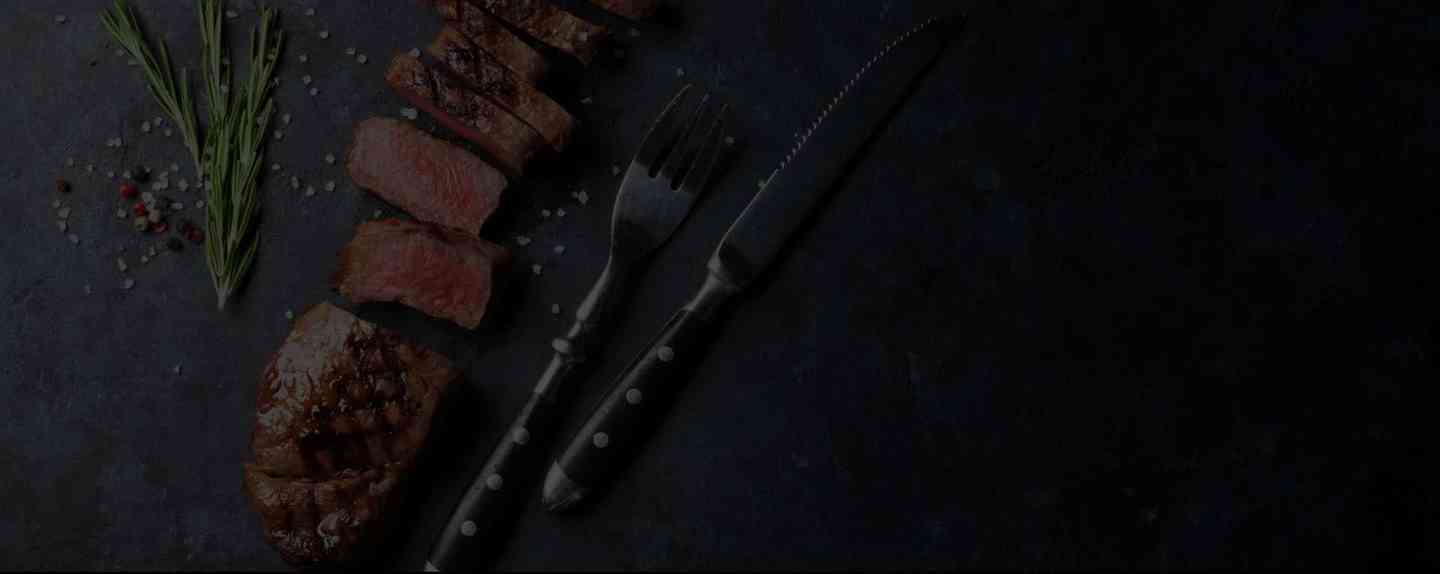 overhead shot of sliced cooked steak with five shots of prepared food in a grid underneath