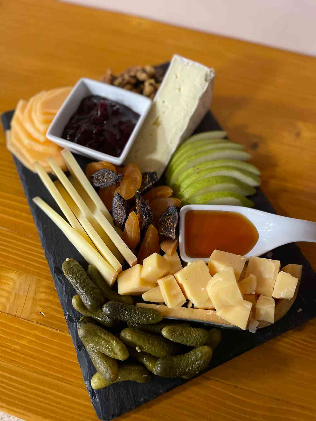 Cheesemonger's Choice Board with bottle of wine
