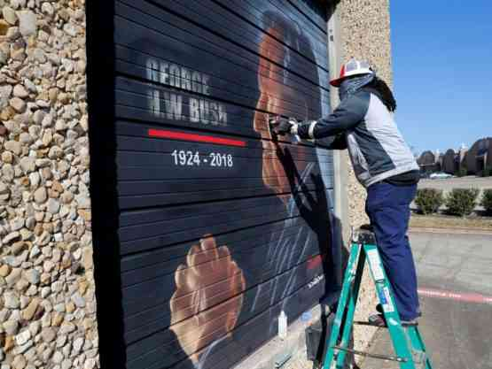 Artist painting a mural for President Bush Sr.