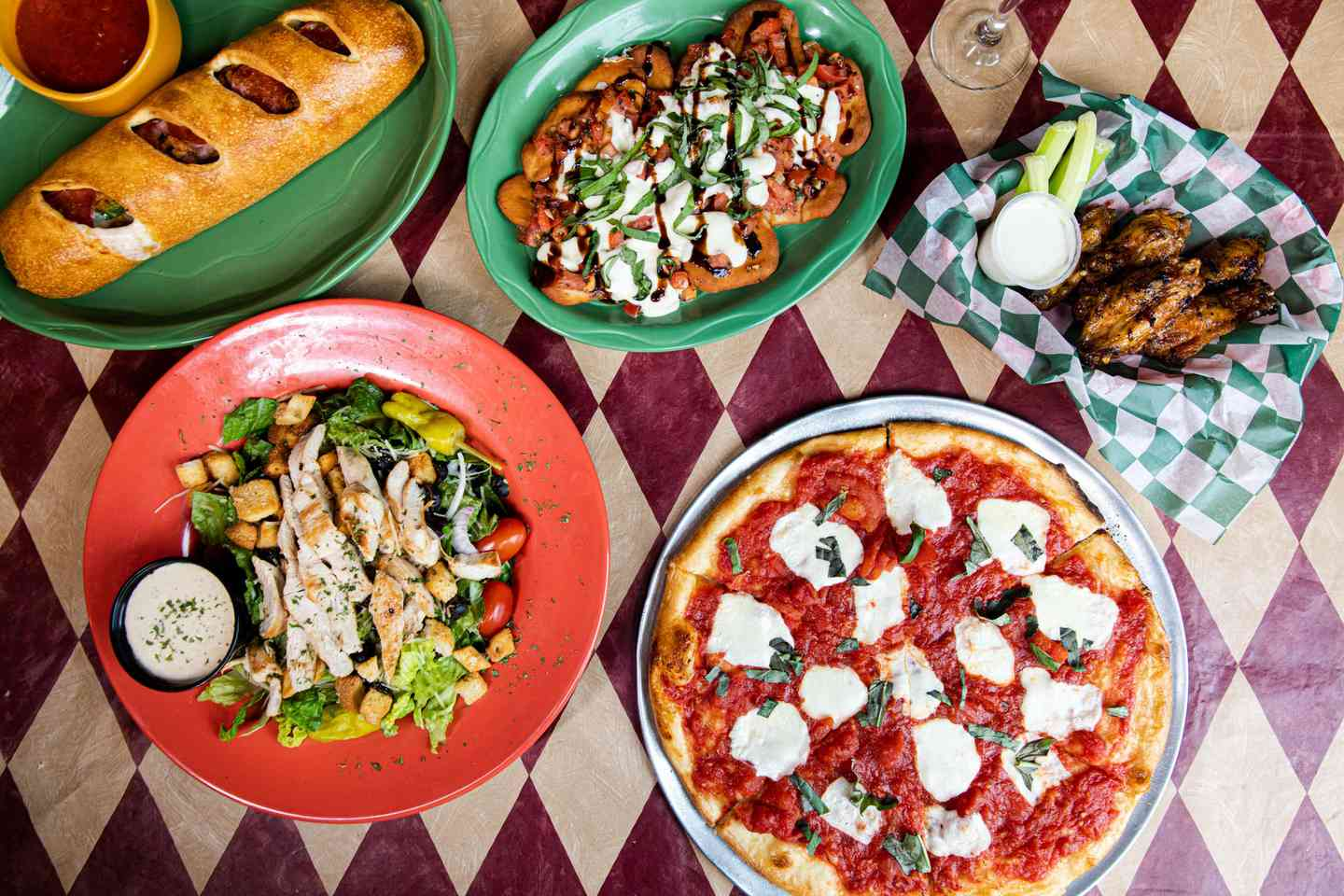 overhead view of pizza and sides