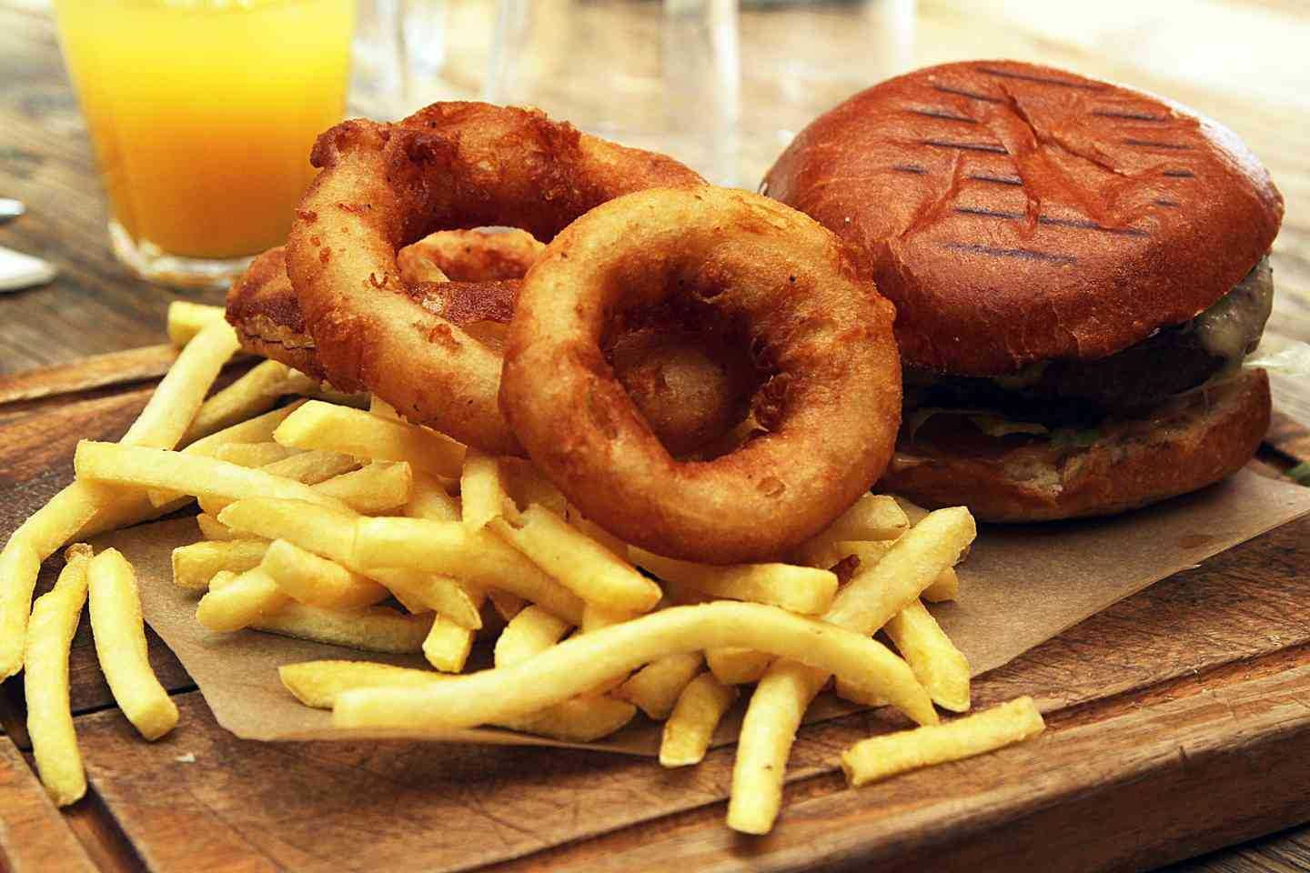 Hamburger with onion rings and fries