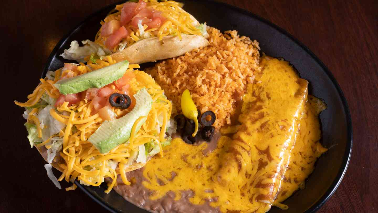 2. Cheese Enchilada*, Bean Tostada and Chicken or Beef Taco