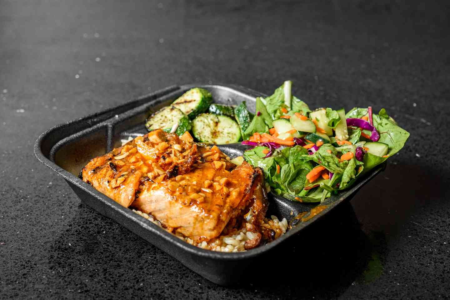 salmon bowl with salad