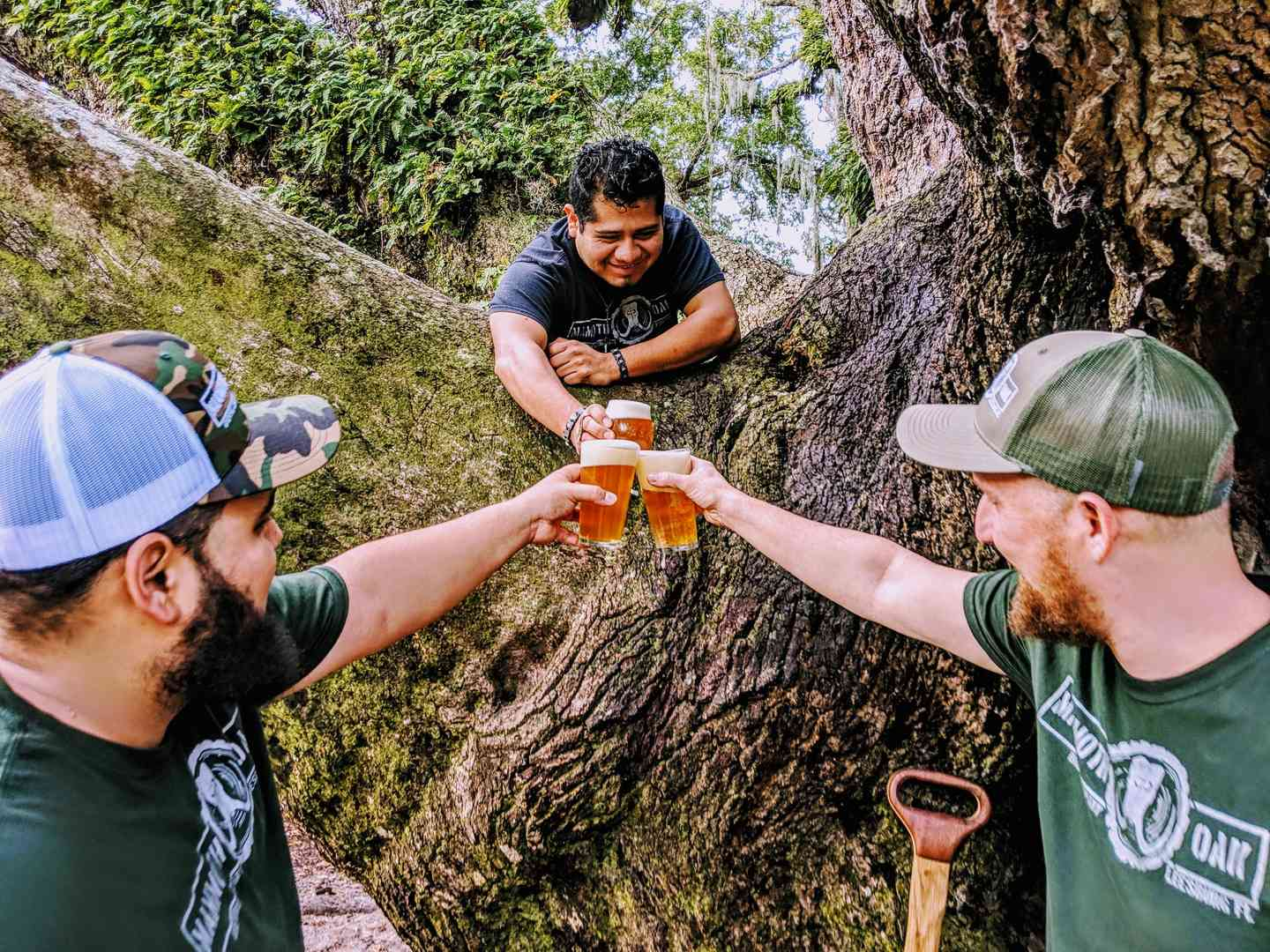 3 friends holding beers toasting