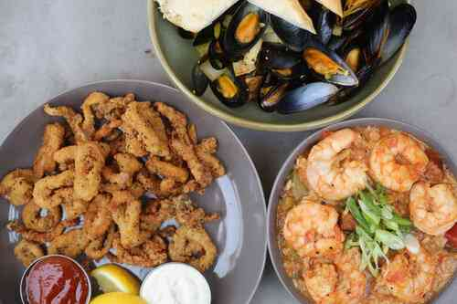 Multiple seafood dishes