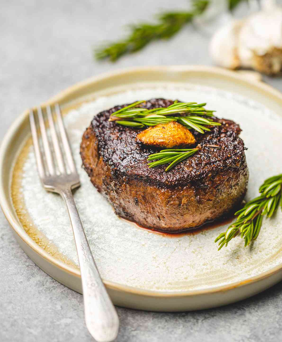 steak with fork and rosemary