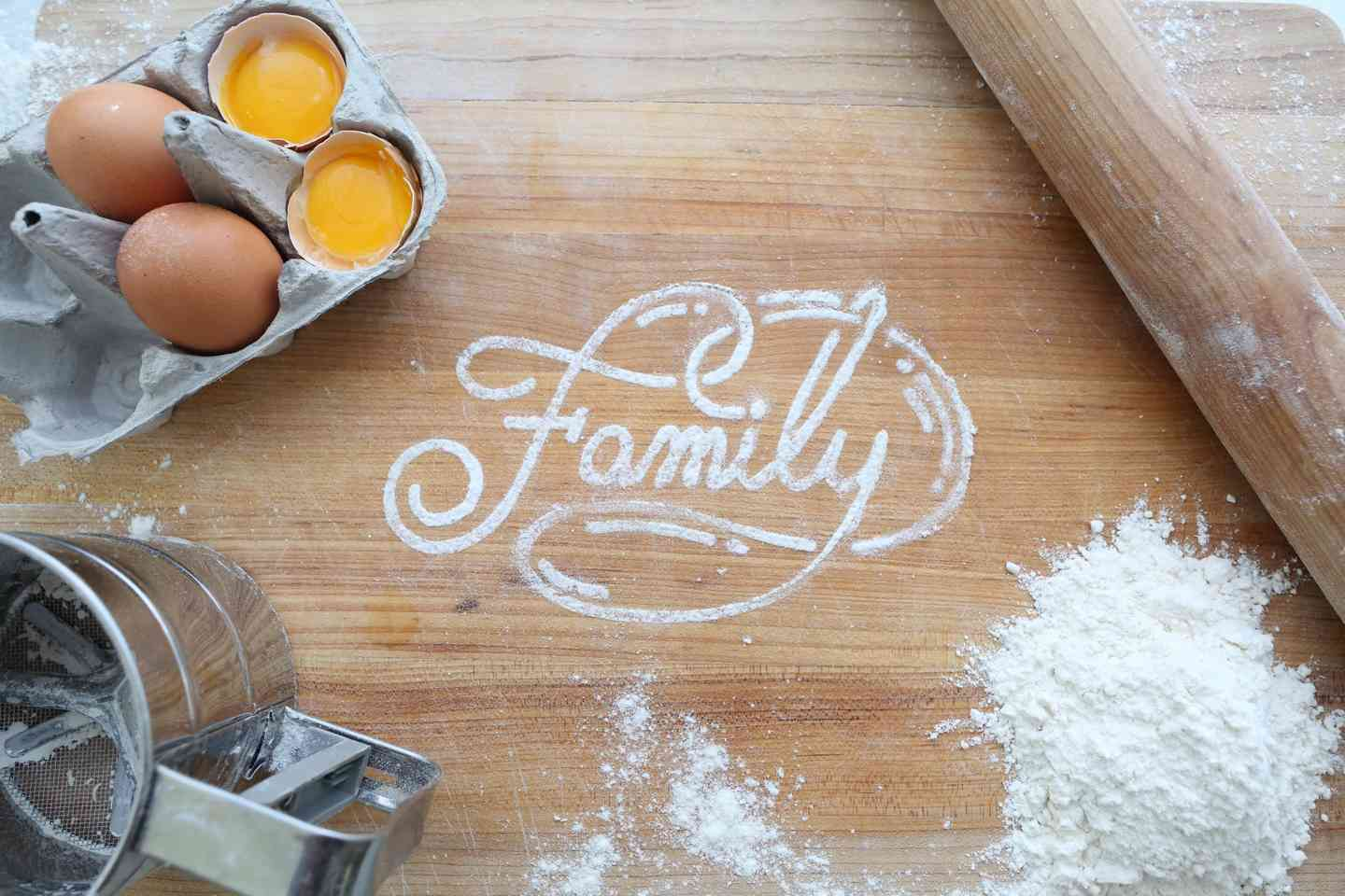 Cutting board with Family written in flour