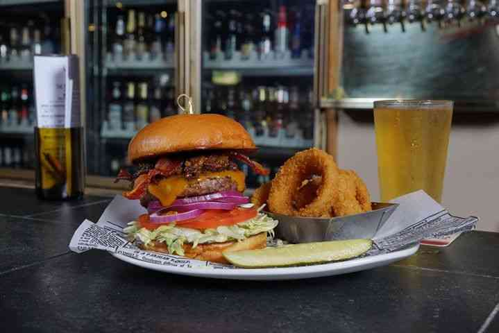 burger and beer on bar
