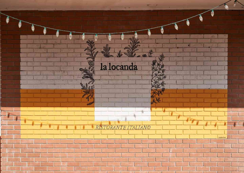 la locanda on brick wall