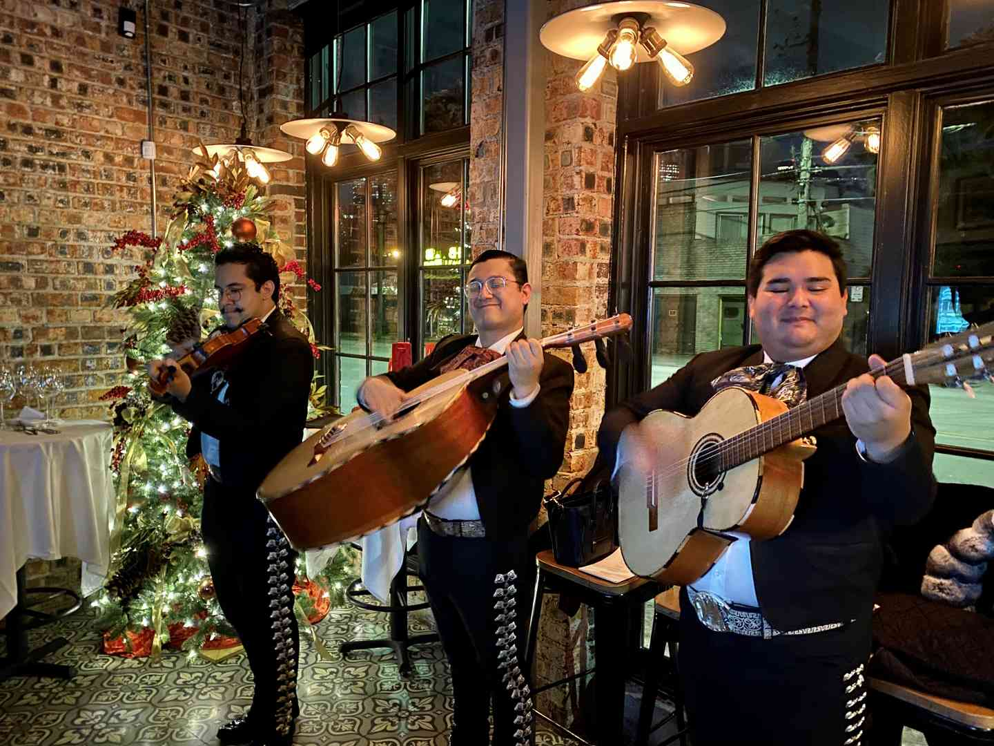 mariachis playing in butcher shop