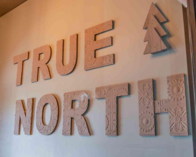 True North wall signage