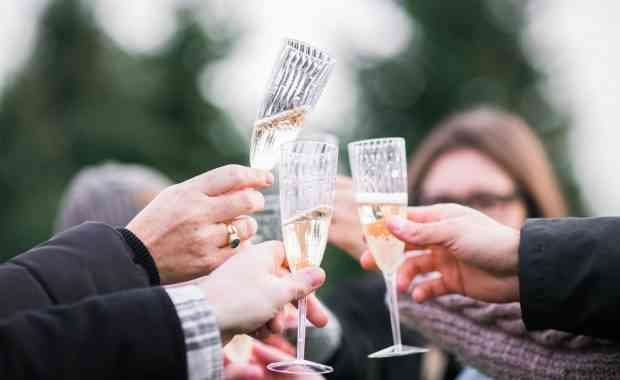 Guests toasting with champagne flutes