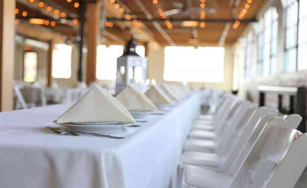 White table cloth seating plated for guests