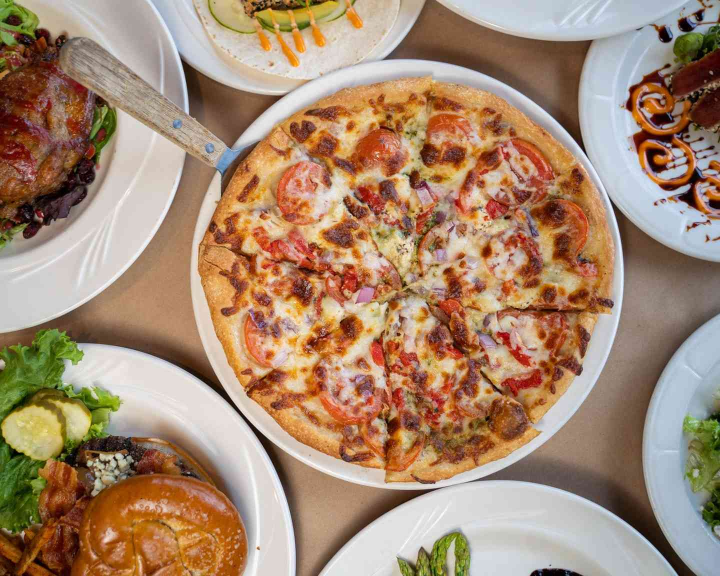 Pizza and assorted dishes at Bricco Akron in Akron, OH