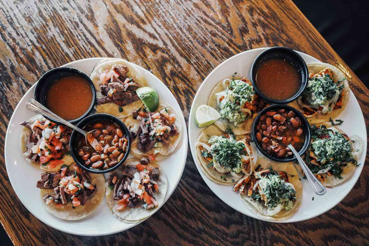 two plates of tacos