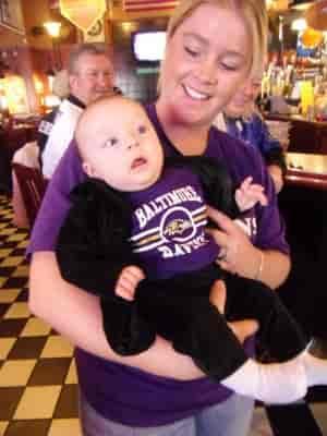 lady with baby wearing fan gear