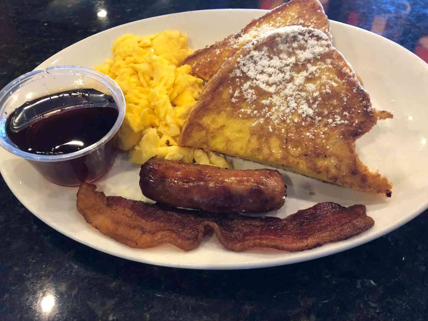 1 Egg, 2 strips Bacon or Sausage links, & 2 slices of French Toast