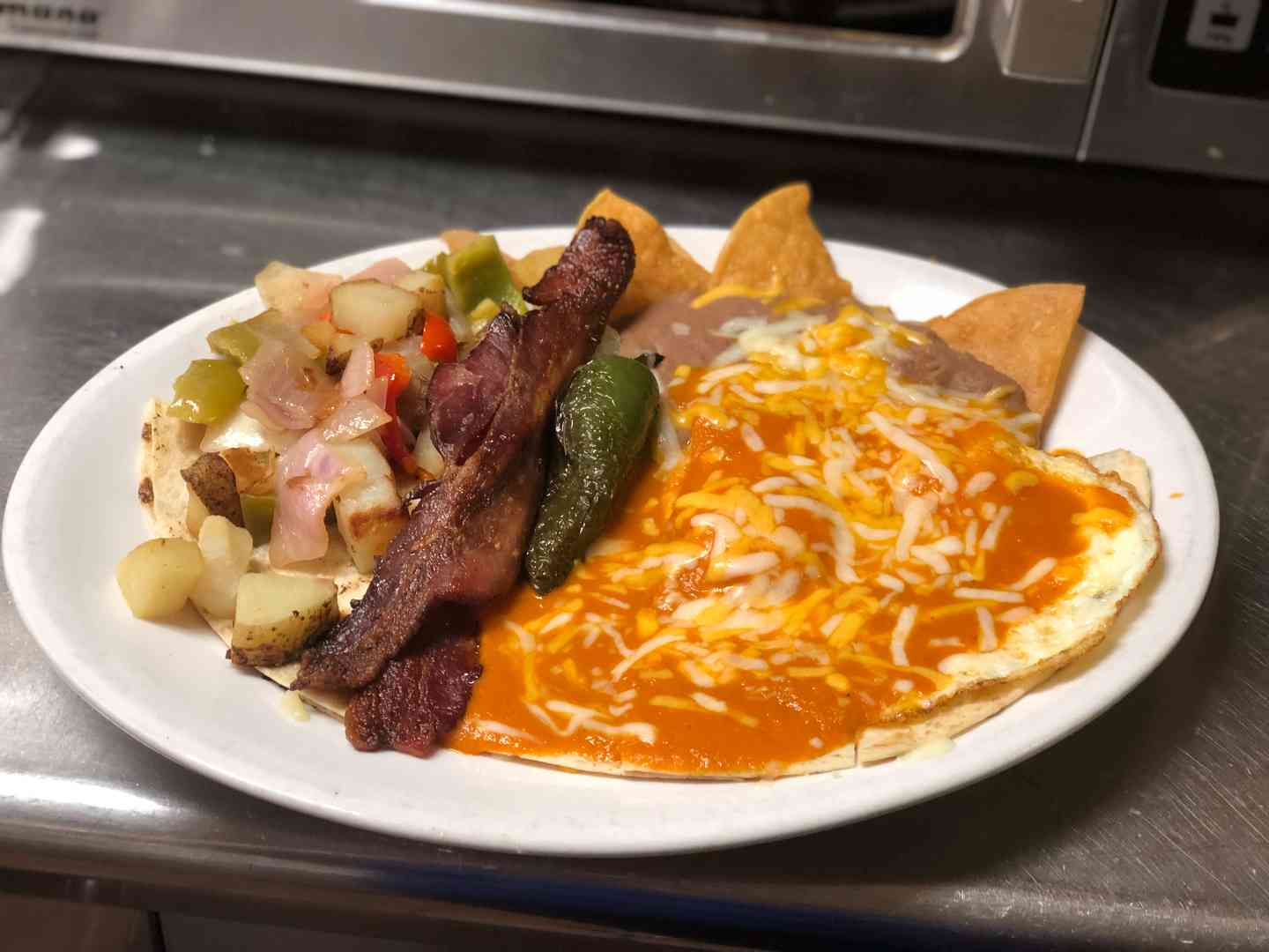 Quesadilla ranchero with basted eggs, and bacon