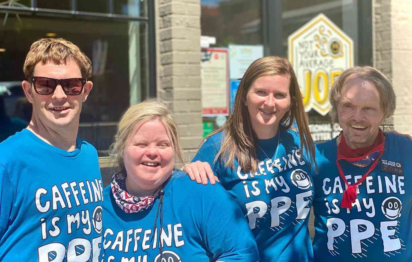 Group wearing 'Caffeine is my PPE' shirts