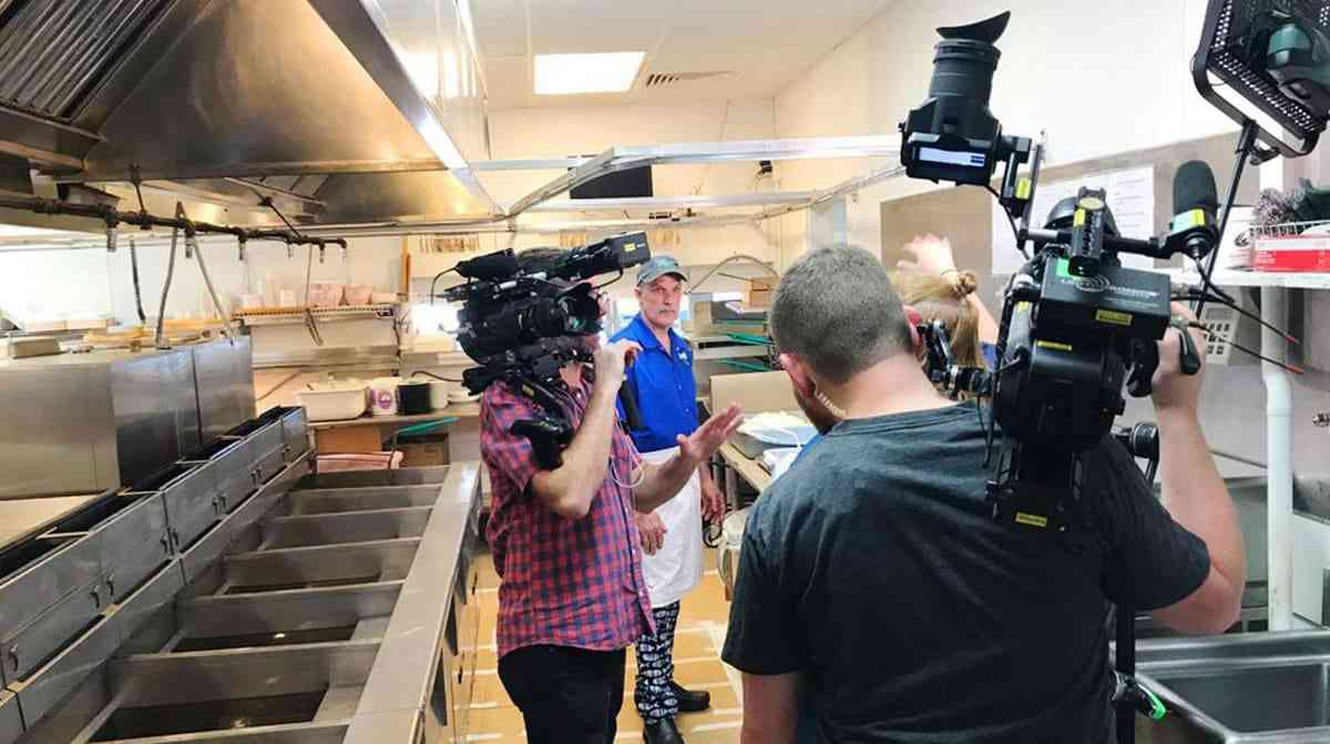 Owner Jeff Lewis shows the TV crew how we make our fried lobster platter.