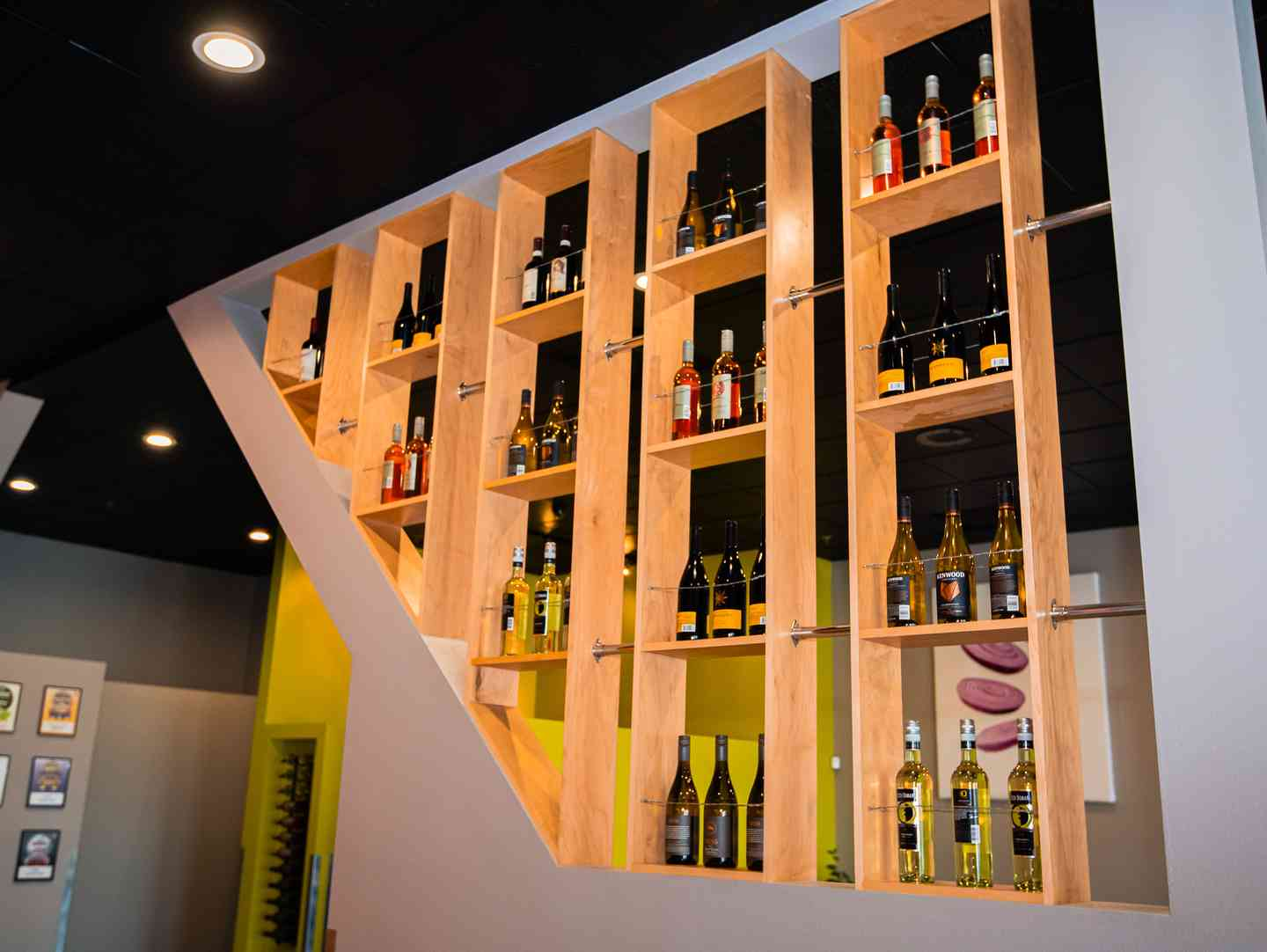 Interior decorative wall with many shelves lined with wine bottles