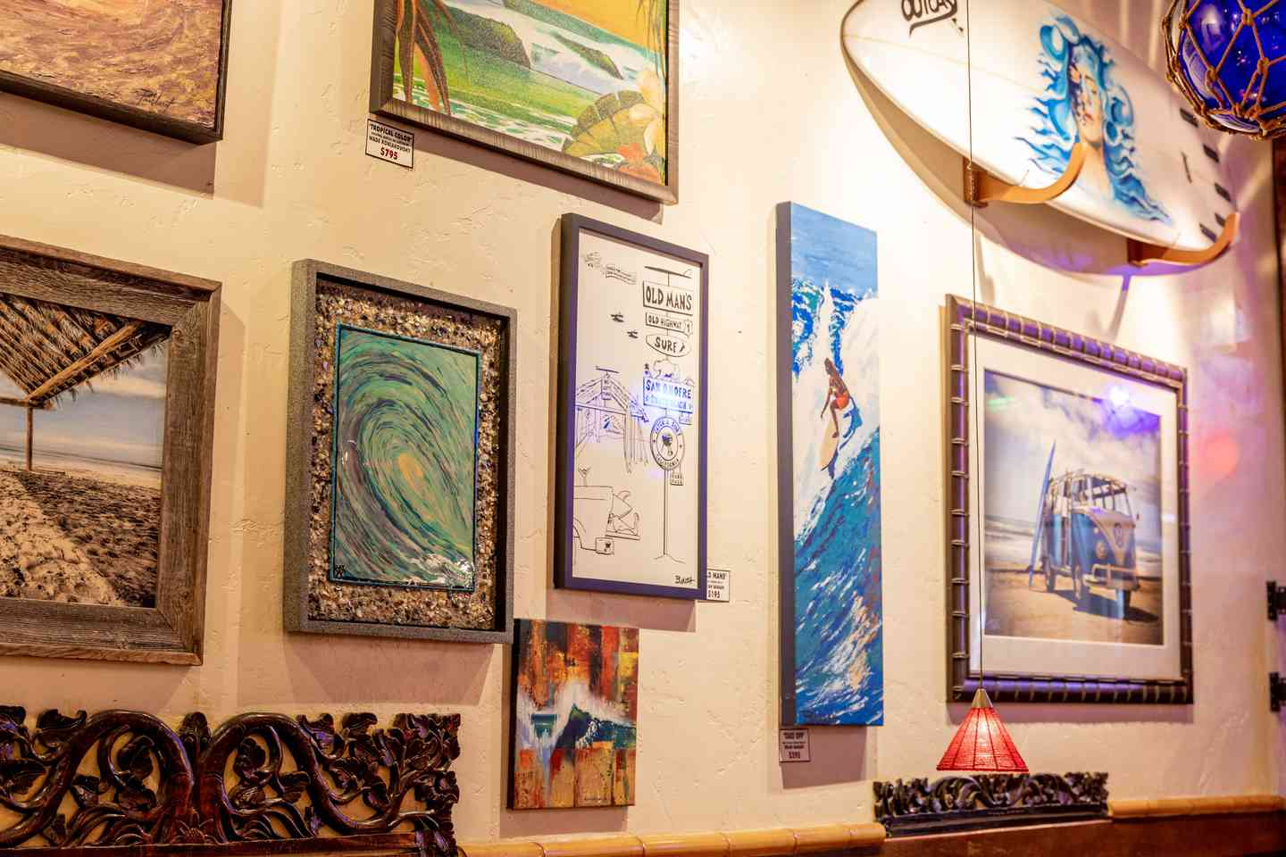 wall of artwork for sale