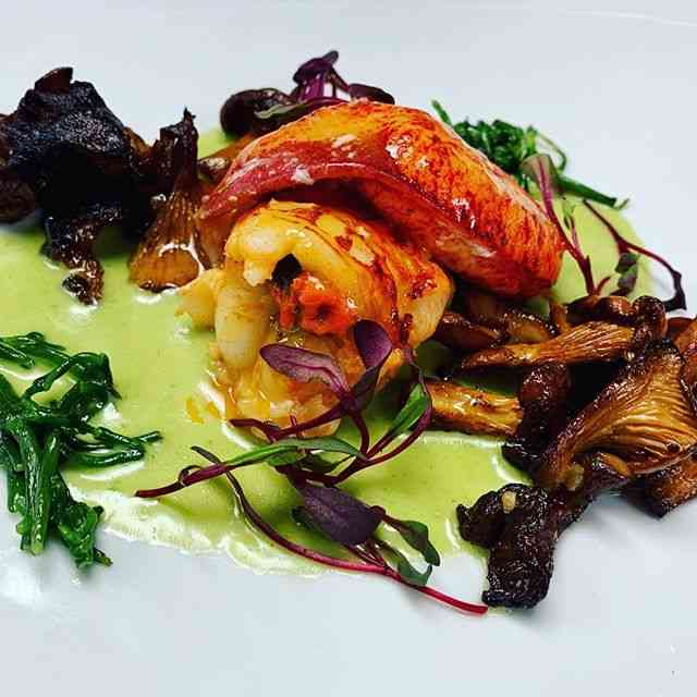 Butter poached lobster with sea beans, chanterelles, chervil lobster sauce