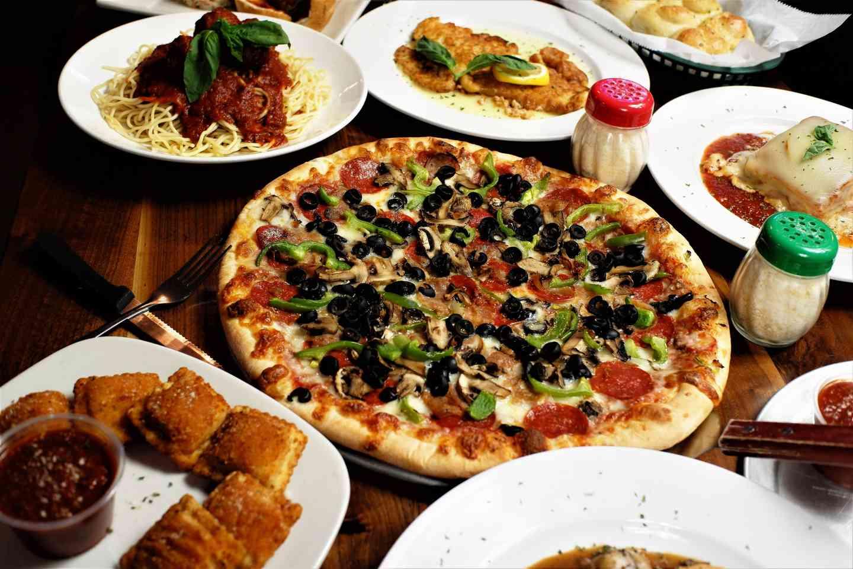 Variety of dishes at Milanias NY Pizza