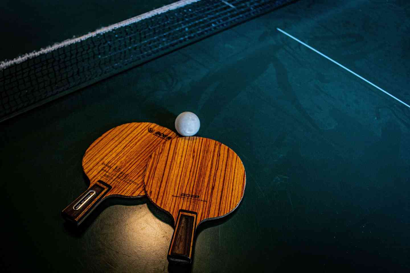 Wooden ping pong paddles with a ping pong ball