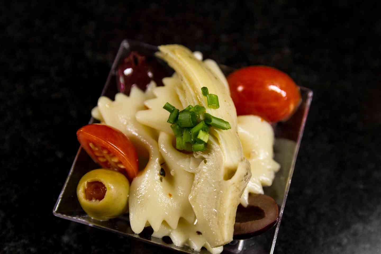 Bowtie Pasta with Marinated Artichokes, Olives, Mozzarella and Tomato