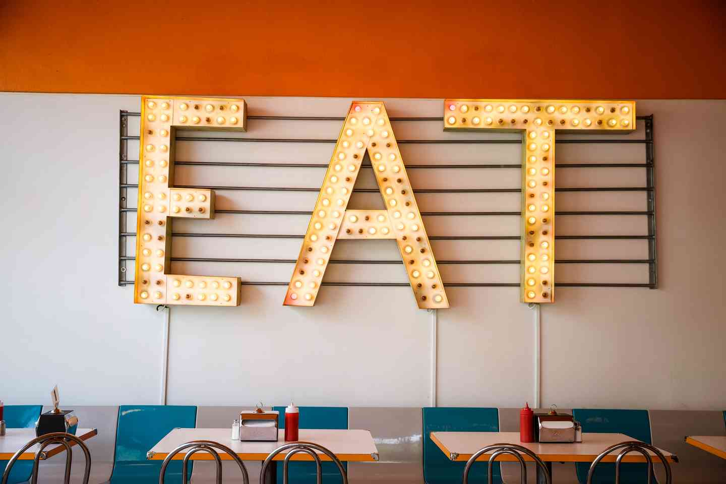"""""""EAT"""" sign on wall"""