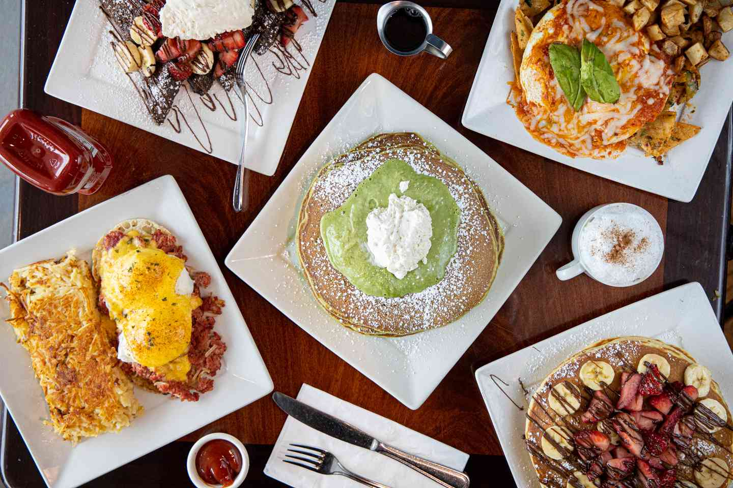 overhead shot of several plates of breakfast food