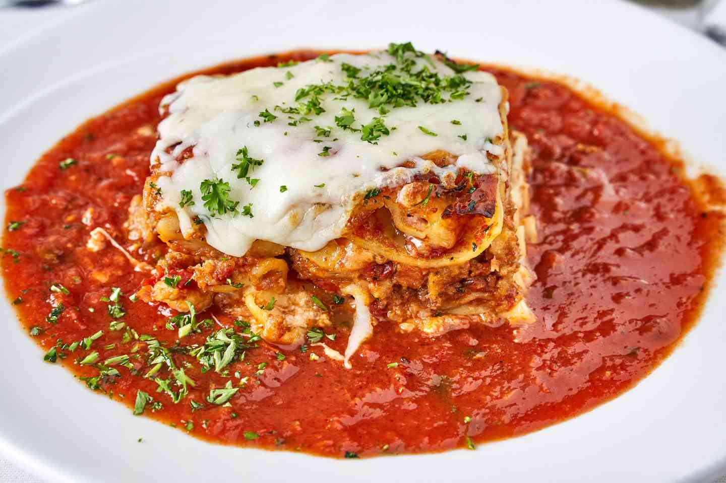 Classic Meat Lasagna Served with Marinara Sauce on The Side