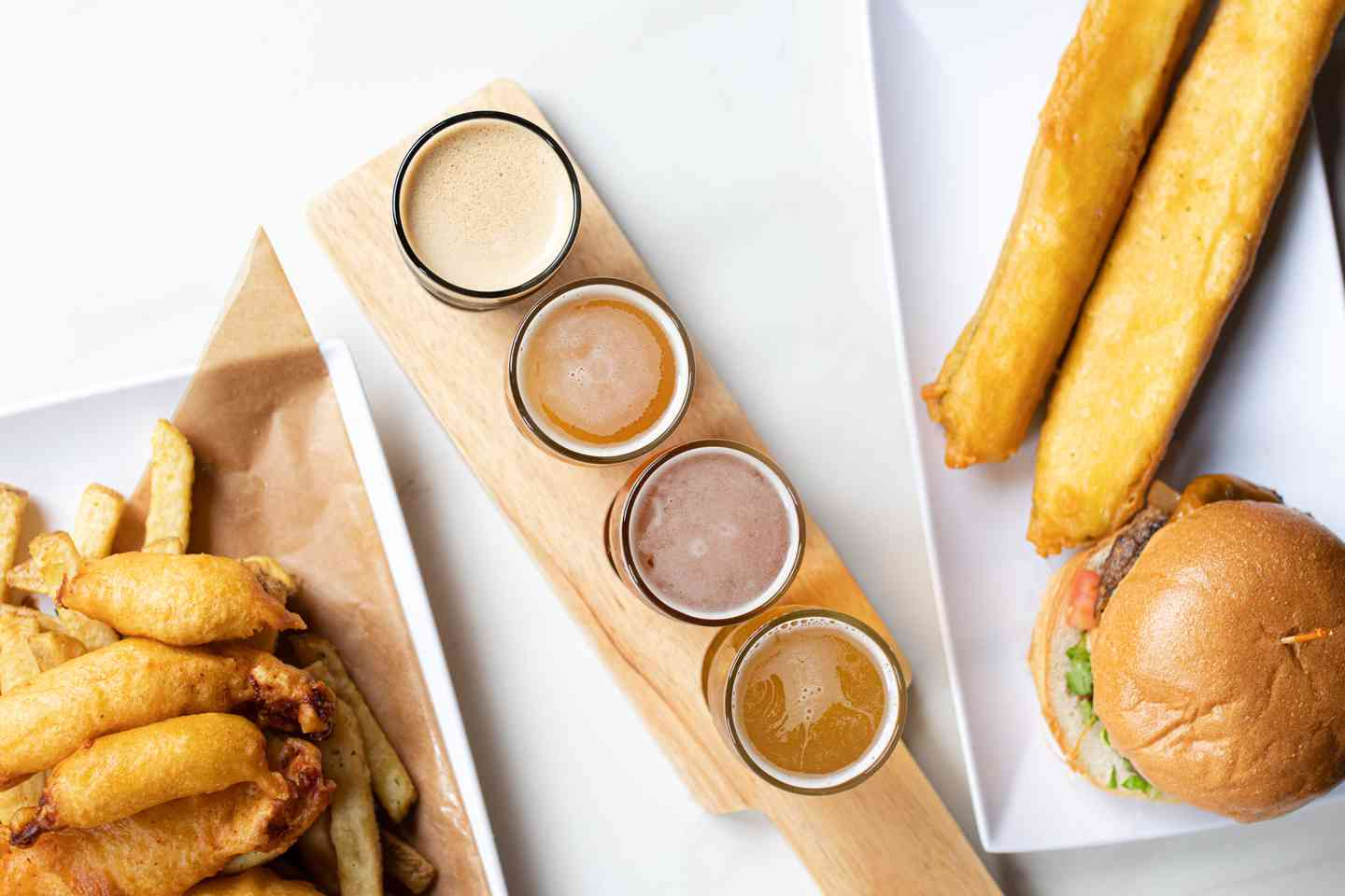 Fish n chips, beer flight, and burger with zucchini