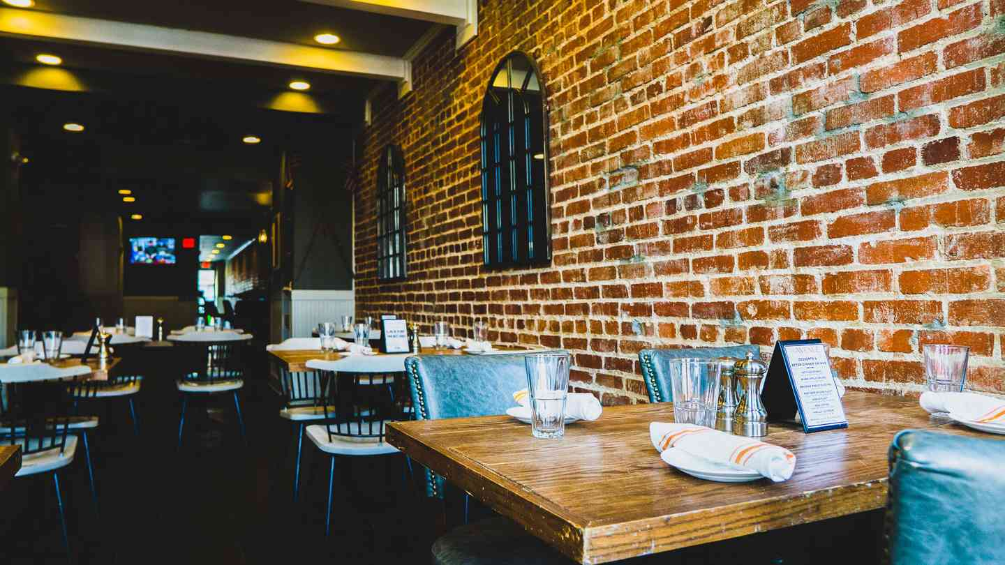 tables with brick wall