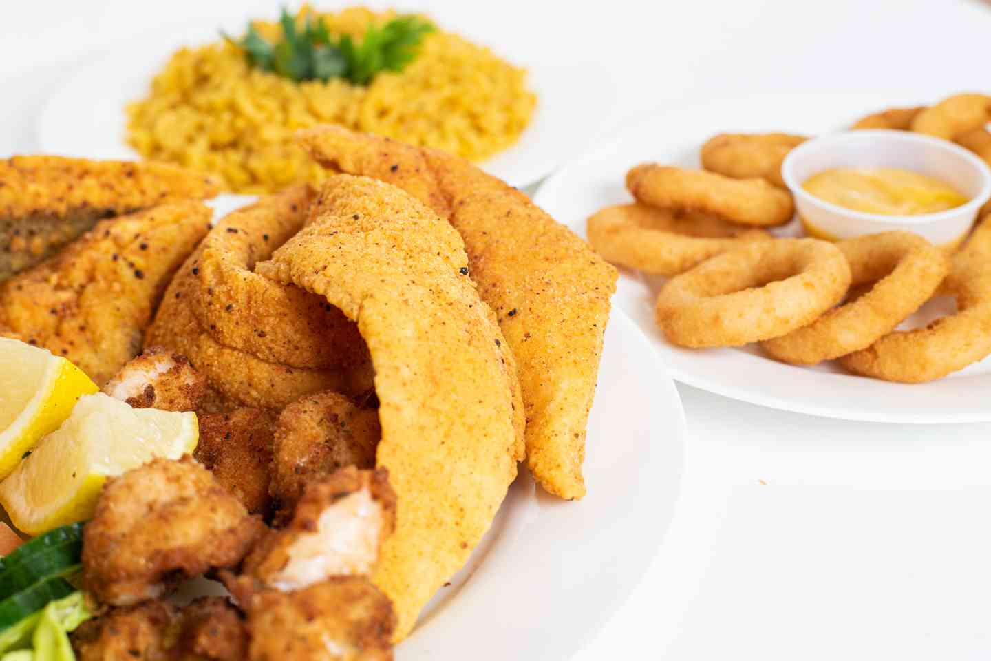 Family pack of chicken, fish, onion rings and rice