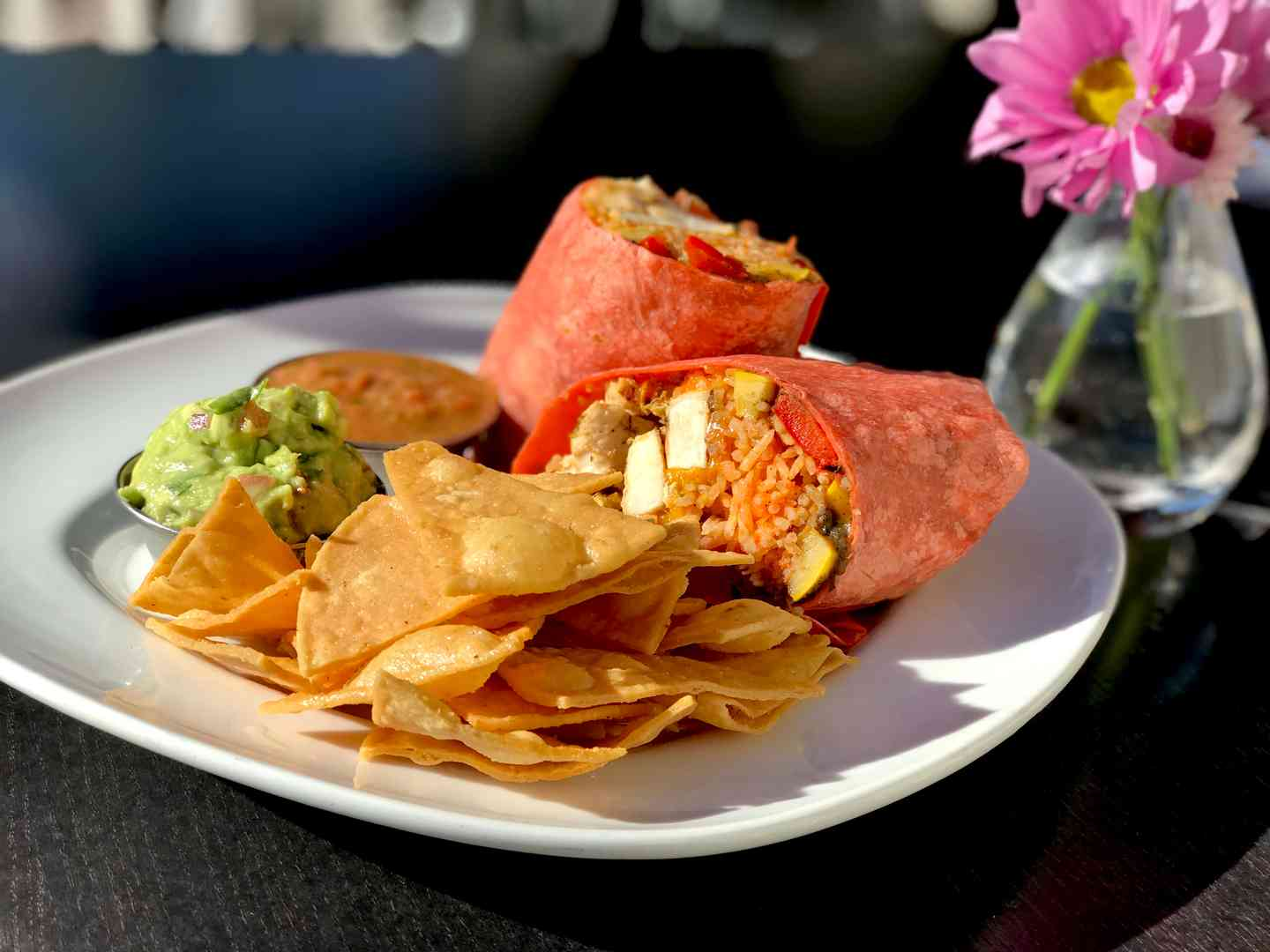 Grilled Jidori Chicken Wrap w/ Grilled Vegetables, Rice, Black Beans, Cheese, Avocado Salsa & Tortilla Chips