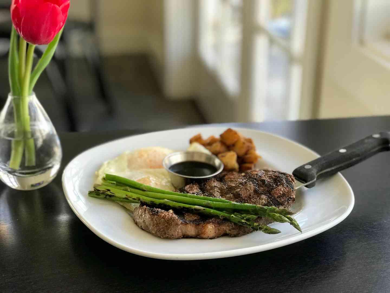 *Cowboy Grilled Filet Mignon w/ Two Eggs Any Style & Potato, Bacon, Asparagus, Cheddar, Scallion, Sour Cream Hash