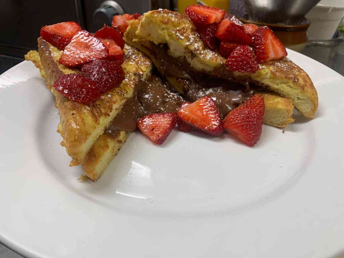 Nutella French Toast topped with powdered sugar & fresh strawberries