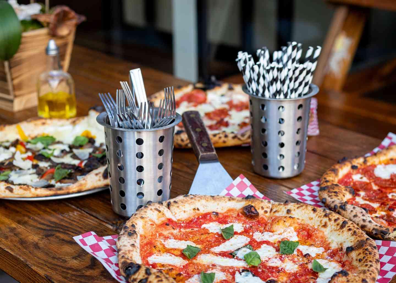 Multiple different pizzas