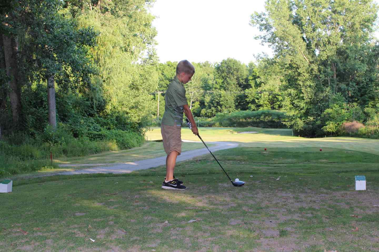 Boy at hole 12 golfing