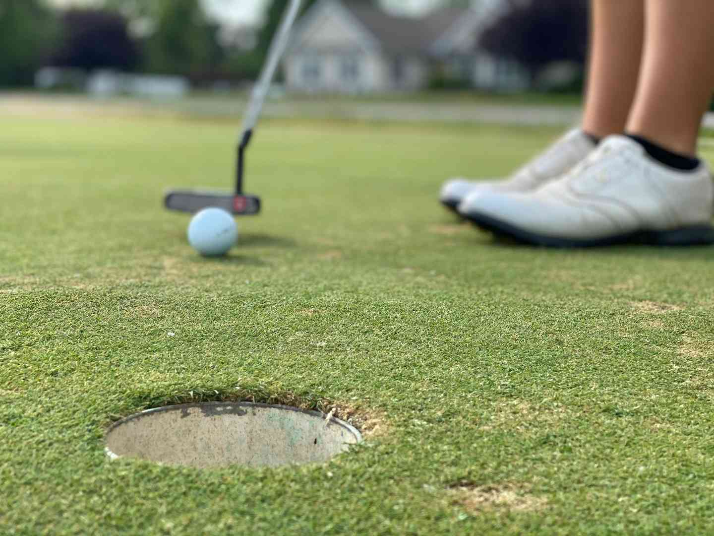 Golf hole with person preparing to hit a golf ball