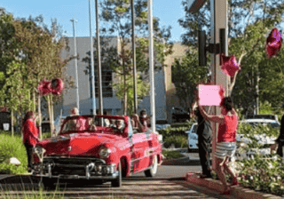 scholarship winners send off to college with a drive by parade
