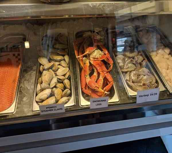crab and mussels displayed in market