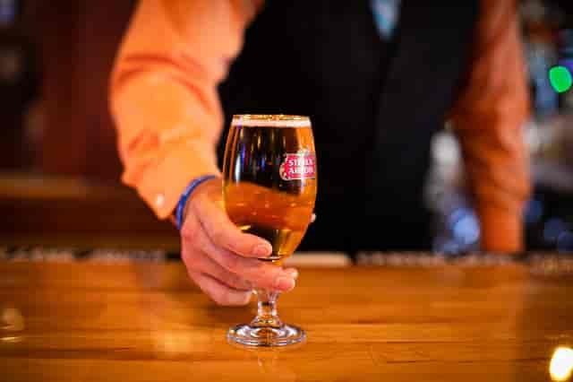 Bartender serving a beer