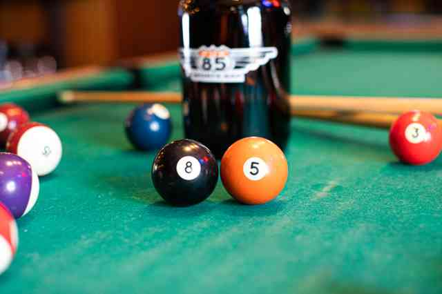 Black and orange pool balls lined up with the numbers 8 5