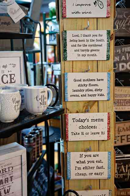 mugs and decorative signs